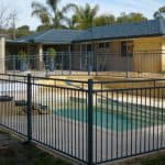 Flat Top Pool Fencing with Raked Panel