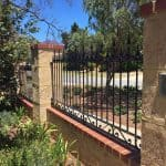 Wrought Iron Infill fencing with scrolls at base 83